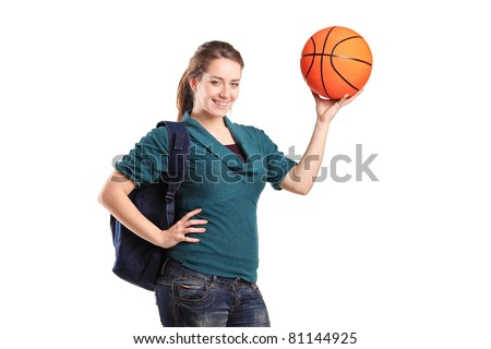 Young school girl holding a basketball isolated on white background - stock photo
