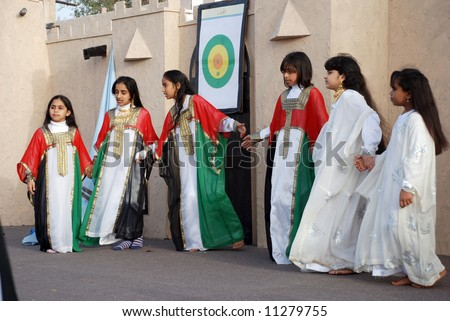 Young school girls at dubai annual festival - stock photo