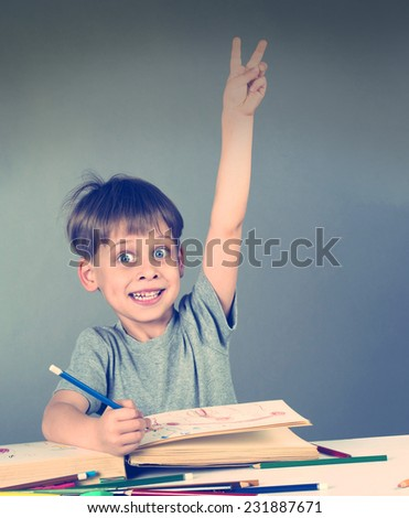 young schoolboy answering - stock photo