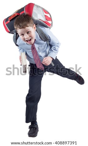 Young schoolboy with school bag in a hurry - stock photo