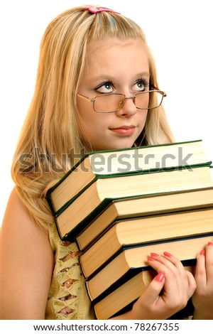 Young schoolgirl in glasses holds some books, it is isolated on white background. - stock photo