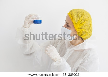 Young scientist holding container - stock photo