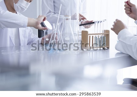 Young scientist works in modern biological lab - stock photo