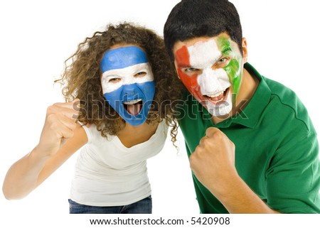 Young, screaming Argentinian and  Italian sport's fans with painted flags on faces and with clenched fists. Front view. Looking at camera, white background - stock photo