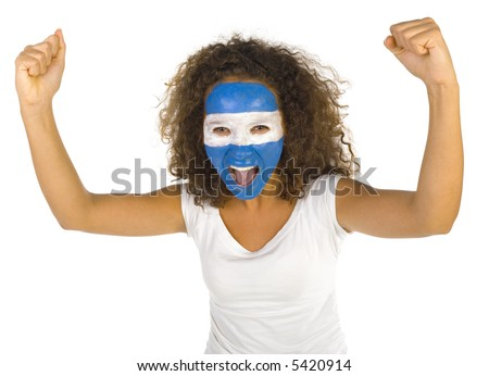 Young screaming Argentinian sport's fan with painted flag on face and with clenched fist. Front view. Looking at camera, white background - stock photo