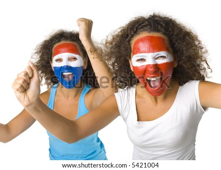 Young, screaming Austrian and  Dutch or Paraguayan sport's fans with painted flags on faces and with clenched fists. Front view. Looking at camera, white background - stock photo