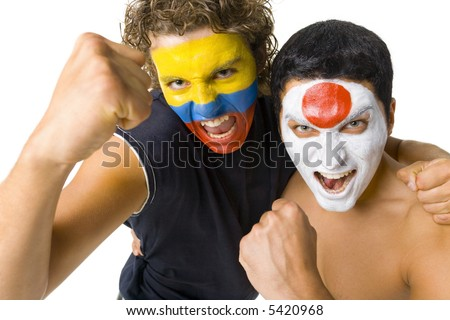 Young, screaming Japanese and Ecuadorian sport's fans with painted flags on faces and with clenched fists. Front view. Looking at camera, white background - stock photo