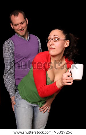 young secretary being immorally touched by her impudent boss - stock photo