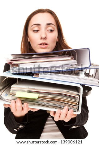 Young secretary in stressed with a ton of documents in folders - stock photo