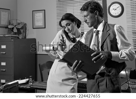 Young Secretary On The Phone And Director Working Together 1950s Vintage Style Office