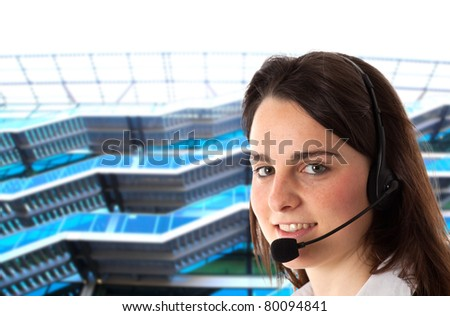 Young secretary smiling while helping a customer. Blue blurred background. - stock photo