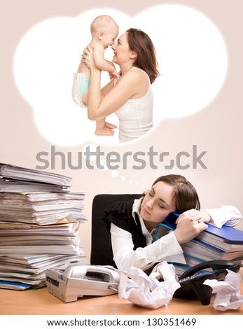 Young secretary with a lot of folders sleeping and dreaming of baby - stock photo
