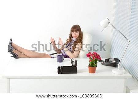 young  secretary with nail file in a comfortable modern office - stock photo