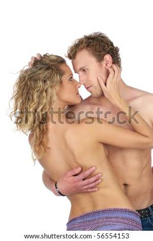 Young semi-dressed couple in love over white background
