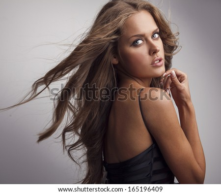 Young sensual & beauty woman in a fashionable black dress.  - stock photo