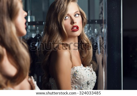 Young sensual & beauty woman in a fashionable dress pose indoor. - stock photo