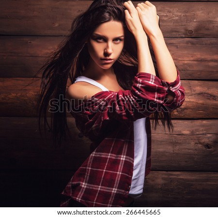 Young sensual & beauty woman in casual clothes pose on grunge wooden background.  - stock photo
