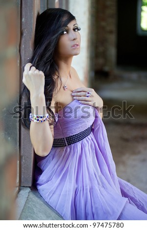 Young sensual beauty woman in violet dress