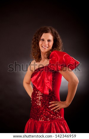 Young sensual brunette  in studio wearing french cancan dress