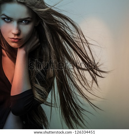 Young sensual model girl. Color face art studio photo. - stock photo
