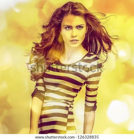Young sensual model girl. Multicolored face art studio photo. - stock photo
