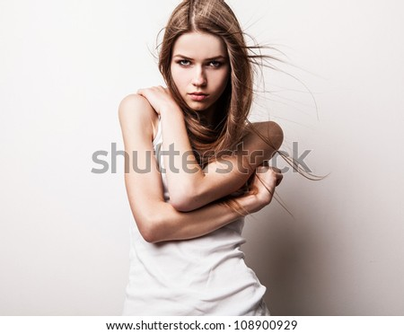 Young sensual model girl pose in studio. - stock photo