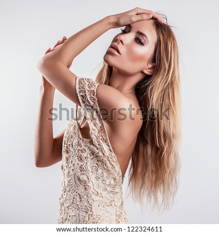 Young sensual model woman pose in studio. - stock photo