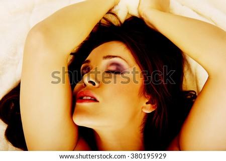 Young sensual woman having orgasm. - stock photo