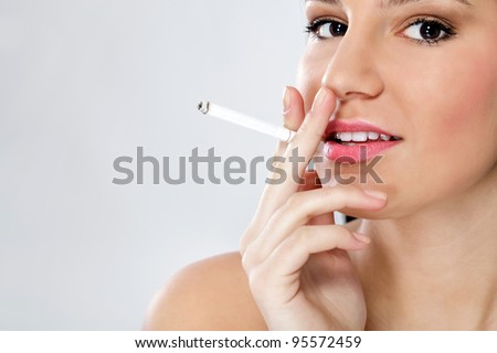Young sensual woman smoking - stock photo