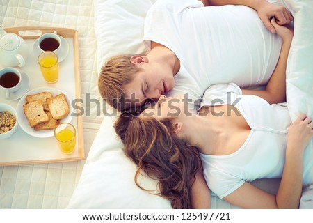 Young serene couple sleeping together