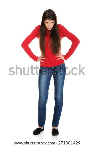 Young serious angry student woman. - stock photo