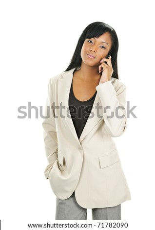 Young serious black businesswoman on cell phone isolated on white background - stock photo