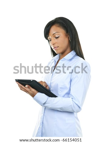Young serious black woman working with tablet computer - stock photo
