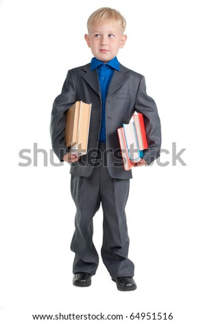 Young serious boy , dressed as professor, holding books under his arms