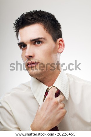 young serious business man portrait close up - stock photo
