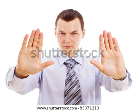 Young serious businessman with open forward palms showing stop gesture. Mask included