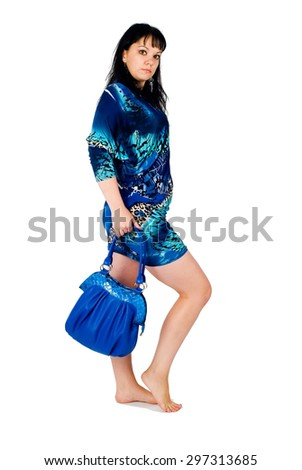 Young serious woman  shopping over white background - stock photo