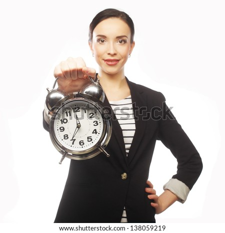 young serious woman with alarm clock isolated on white. - stock photo