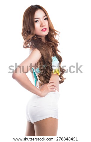 Young sexy asian girl in bikini and white short pant. - stock photo