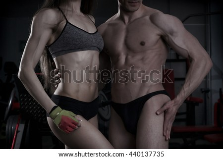 Young sexy athletic man and woman after fitness exercise. Perfect muscular body. Toning image - stock photo