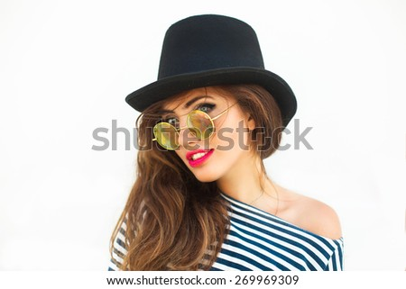 Young sexy blonde woman with red lips,wearing frock,black hat mirrored sunglasses and bright make up,Smiling,Lifestyle portrait bright toned colors.Reflecting round bright Sunglasses.Summer vintage - stock photo