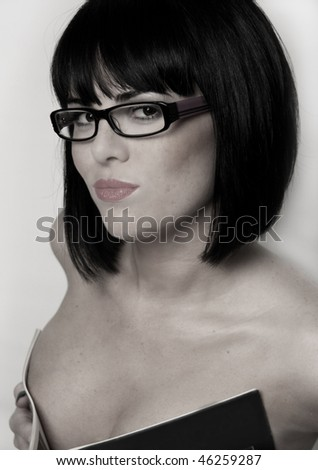 young sexy brunette in glasses isolated on white