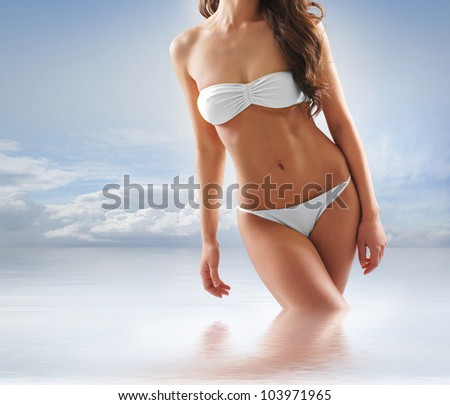 Young sexy brunette in swimsuit - stock photo