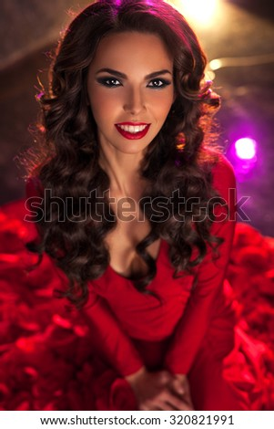 Young sexy brunette woman fashion portrait in red dress. - stock photo