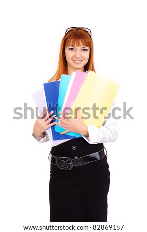 young sexy business woman with red hair with colour folders staying, isolated on white