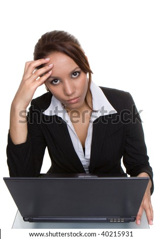 young sexy businesswoman having a  headache working on her laptop - stock photo