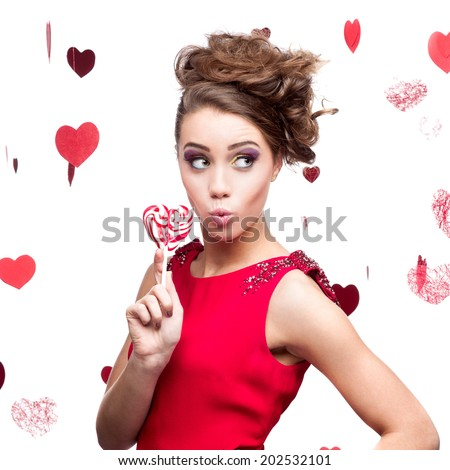 young sexy caucasian brunette woman holding lollipop - stock photo
