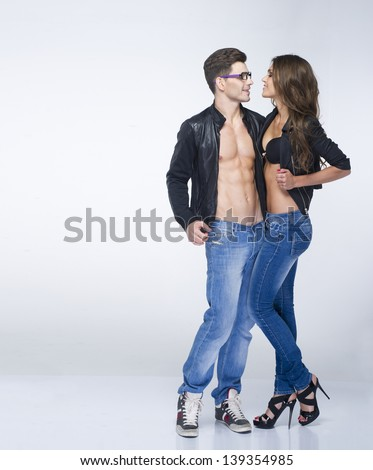 Young sexy couple in embracing - stock photo