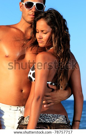 Young sexy couple on beach - stock photo