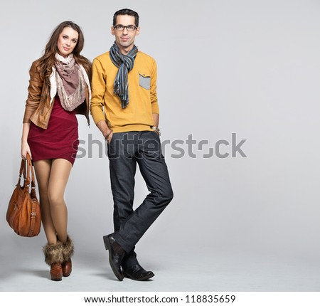 Young sexy couple on white background - stock photo